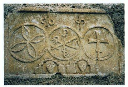 sculpted ornament on a Templar church;  chrismon with the inscription: 'Pax'; photo by JP Schmit